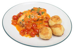 Italain Chicken Cacciatore. Italian chicken cacciatore with cherry tomatoes, mascarpone and basil. Served with roasted potatoes Stock Photography