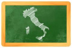 Italia dibujada en un tablero negro Foto de archivo libre de regalías