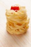Italiaanse deegwaren en tomaat Royalty-vrije Stock Afbeeldingen