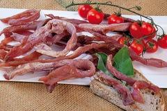 Italiaanse droge geïsoleerde ham en Toscaans brood Royalty-vrije Stock Foto's