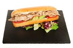 Italiaanse Sub Lange Baguette met Ham Cheese Tomato en Sla Stock Afbeelding