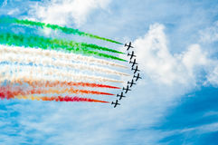 Italian acrobatic airplanes team drawing italian flag in blue sky. Italy acrobatic airplanes team flying in sunny day making italy flag Royalty Free Stock Photography
