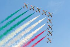 Italian acrobatic patrol Frecce Tricolori. Frecce Tricolori, Italian national air patrol, flying in formation during air show with tricolor smoke Stock Images