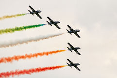 Italian aerobatics team in formation deploying smoke Royalty Free Stock Photos