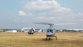 Italian Agusta A109S Grand helicopter takes off from field stock footage