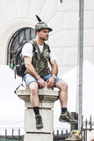 Italian alpine military man sitting on a column, watching to the parade Stock Photography