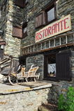 Italian alpine restaurant and wooden sledge. Aosta Valley, Italy Royalty Free Stock Image
