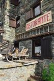 Italian alpine restaurant and wooden sledge. Aosta Valley, Italy royalty free stock image