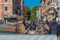 Italian alpini soldiers with weapons guarding the streets in Rom Royalty Free Stock Photo