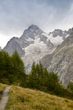 Italian Alps. Views of Mont-Blanc with dramatic grey sky , Italian Alps Stock Photography