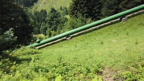 Italian Alps. Italy. Forced water conduit that carries water from the dam to the power plant for power generation. Green and clean energy stock video footage