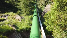 Italian Alps. Italy. Forced water conduit that carries water from the dam to the power plant for power generation. Green and clean energy stock footage