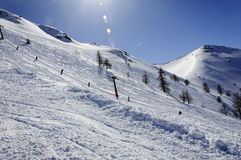 Italian alps - Skier on a ski lift - Bardonecchia. Vallon Cross Stock Image