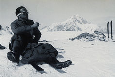 Italian Alps 1939 Vintage skier rests smoking a cigarette on the top Stock Photos