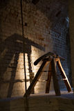 Italian ancient defence gun in stone fortress. View of a siege machine in italian old fortress, lighted for tourists Stock Photo