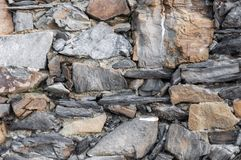 Italian ancient house: typical stone wall of Vernazza stock image