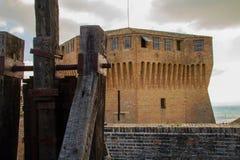 Italian ancient stone fortress and siege machine. View of italian old fortress in Mondavio Stock Photo
