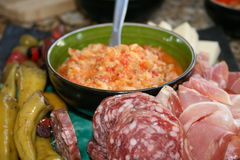 Italian Anitipasto Appetizer. Antipasto plater with prosciutto, salami, peppers, and garlic. Delicious stock images