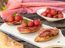 Italian antipasti bruschettas with ham prosciutto, coppa, salami Royalty Free Stock Images
