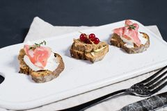 Italian antipasti with pate, Parma and salami on toast. stock images