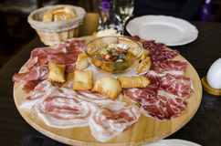 Italian antipasti. A serving of Italian antipasti, Parma ham, prosciutto, torta fritta, pickled vegetables and various meats Stock Photo