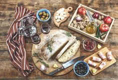 Italian antipasti with wine and delicious snacks. Olives, Parmesan, Greek Nuts and Fruits. Top view royalty free stock photo