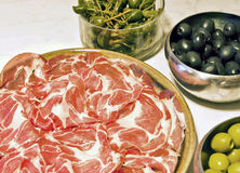 Italian antipasto, coppa, olives and capers Stock Image