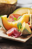 Italian antipasto with prosciutto and sweet fresh melon Royalty Free Stock Image