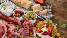 Italian antipasto on wooden table. Royalty Free Stock Photos