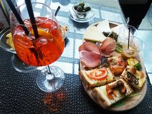 Spritz aperitif. A italian aperitif with spritz and food royalty free stock image