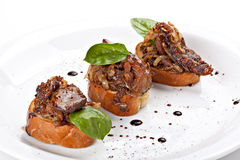 Italian appetizer bruschetta with meat Royalty Free Stock Photo