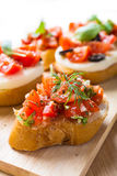 Italian Appetizer Bruschetta. With roasted tomatoes, mozzarella cheese, garlic and herbs Royalty Free Stock Photos