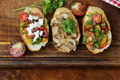 Italian appetizer bruschetta with tomatoes, olives, cheese Royalty Free Stock Photo
