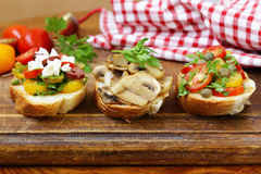 Italian appetizer bruschetta with tomatoes, olives, cheese Royalty Free Stock Image