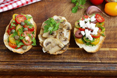 Italian appetizer bruschetta with tomatoes, olives, cheese Royalty Free Stock Images