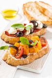 Italian appetizer - bruschetta on wooden board, vertical Royalty Free Stock Photo