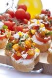 Appetizer called Bruschetta Stock Photos