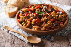 Italian appetizer Caponata close-up on a wooden plate. Horizonta Stock Images