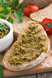 Italian appetizer - ciabatta with pesto, close-up Stock Images