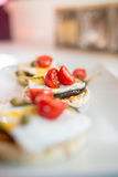 Italian appetizer of corn cracker with egg and grilled aubergine Royalty Free Stock Image