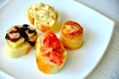 Italian appetizer, finger food on a white plate  Royalty Free Stock Image