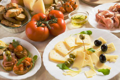Italian appetizer food. Cold buffet with cheese, olives, tomato and other italian appetizer food Stock Photography
