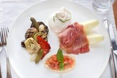Italian appetizer prosciutto mozzarella bruschetta Stock Images