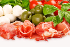 Italian appetizer: prosciutto, mozzarella, cherry tomatoes, lettuce Stock Photos