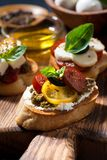 Italian appetizers - various bruschettas, closeup vertical Royalty Free Stock Photography