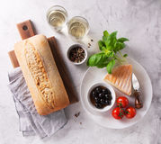 Italian appetizers, view from above - bread ciabatta, olives, tomatoes, cheese, pepper, fresh basil and wine Stock Photography