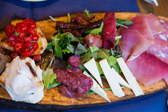 Italian appetizers on a wooden board. Set of italian appetizers on a wooden board Royalty Free Stock Photos