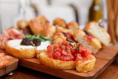 Italian appetizers on wooden plank Royalty Free Stock Images
