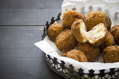 Italian Arancini. Deep fried italian arancini on dark wood background Royalty Free Stock Images