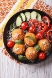 Italian arancini rice balls with cheese close-up. vertical top v Royalty Free Stock Images